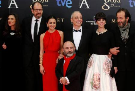 "Director Berger poses with cast members of ""Blancanieves"" as they arrive for the Spanish Film Academy's Goya Awards ceremony in Madrid"